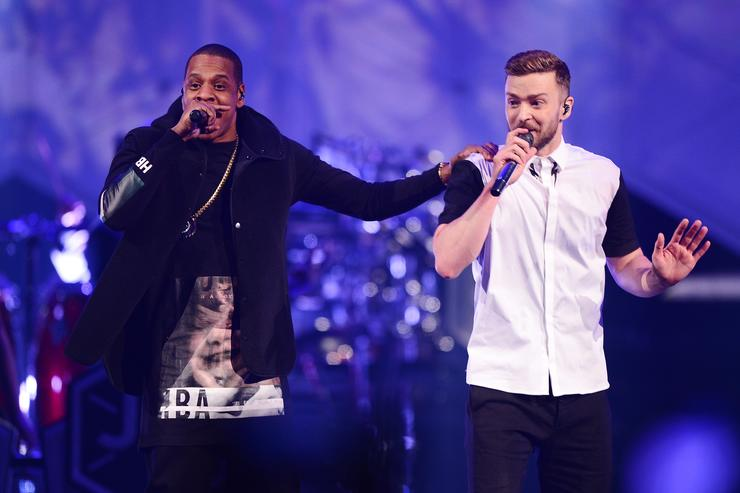 Jay-Z (L) and musician Justin Timberlake perform on stage at Barclays Center on December 14, 2014 in the Brooklyn borough of New York City