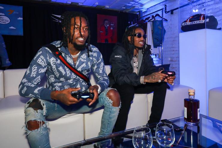 Rappers Offest (L) and Quavo play XBOX at the H.O.M.E. by Martell event on November 29, 2017 in Detroit, Michigan