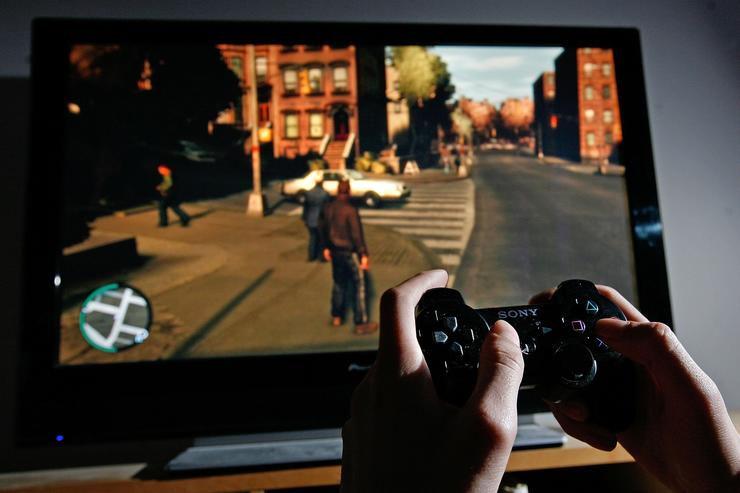 A young man plays Grand Theft Auto IV on the game's day of release on April 29, 2008 in London, England. The game designed for the Playstation 3 was in high demand and sold out in stores across London during its first day of sale