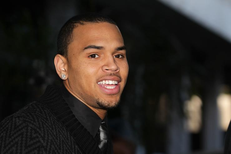 Recording artist Chris Brown leaves the Los Angeles courthouse after a probation progress hearing on January 28, 2011 in Los Angeles, California. Brown pleaded guilty to assaulting his then-girlfriend, singer Rihanna, after a pre-Grammy Awards party in 2009. He was given a sentence of five years probation and ordered to complete 180 days of community labor and a year of domestic violence counseling.