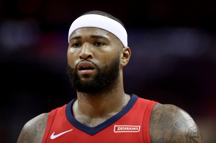 DeMarcus Cousins helped off the court after apparent non-contact leg injury