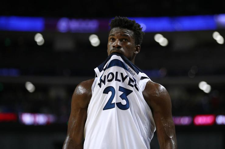 Jimmy Butler of Minnesota Timberwolves meets with players after heated practice appearance